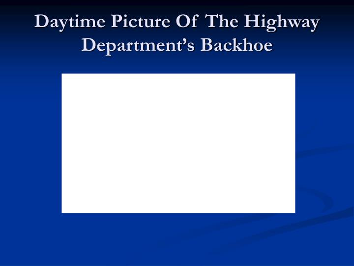 Daytime Picture Of The Highway Department's Backhoe