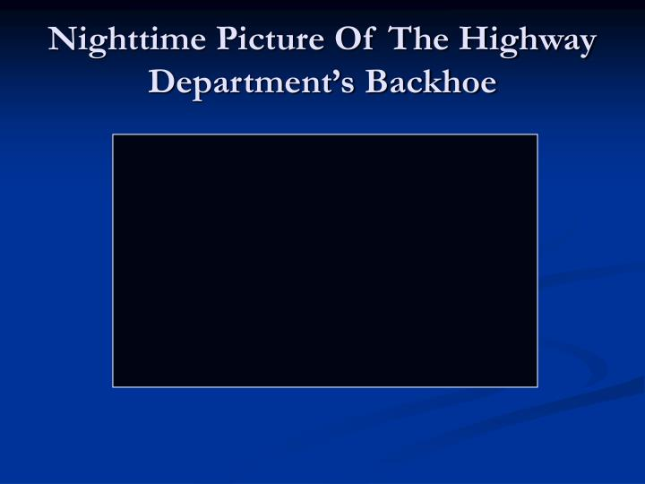 Nighttime Picture Of The Highway Department's Backhoe