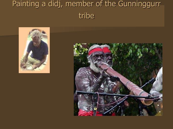 Painting a didj, member of the Gunninggurr tribe