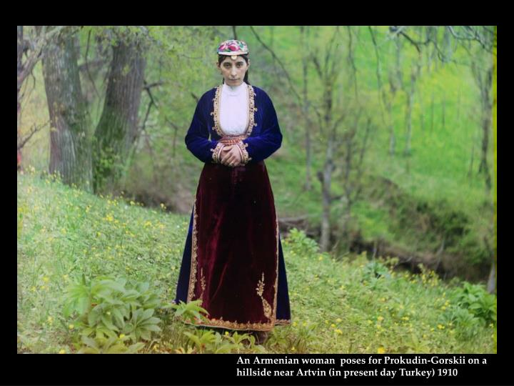 An Armenian woman  poses for Prokudin-Gorskii on a hillside near Artvin (in present day Turkey) 1910