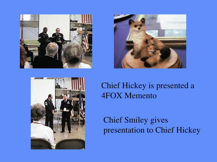 Chief Hickey is presented a
