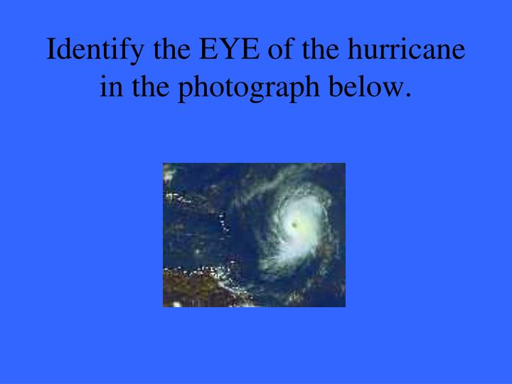 Identify the EYE of the hurricane in the photograph below.