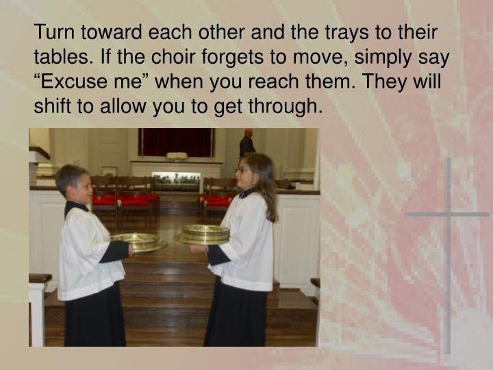Turn toward each other and the trays to their