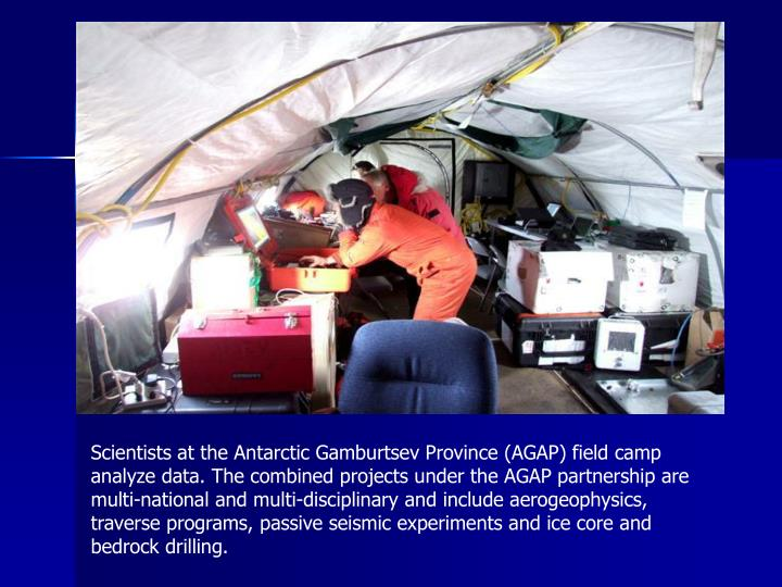Scientists at the Antarctic Gamburtsev Province (AGAP) field camp analyze data. The combined projects under the AGAP partnership are multi-national and multi-disciplinary and include aerogeophysics, traverse programs, passive seismic experiments and ice core and bedrock drilling.