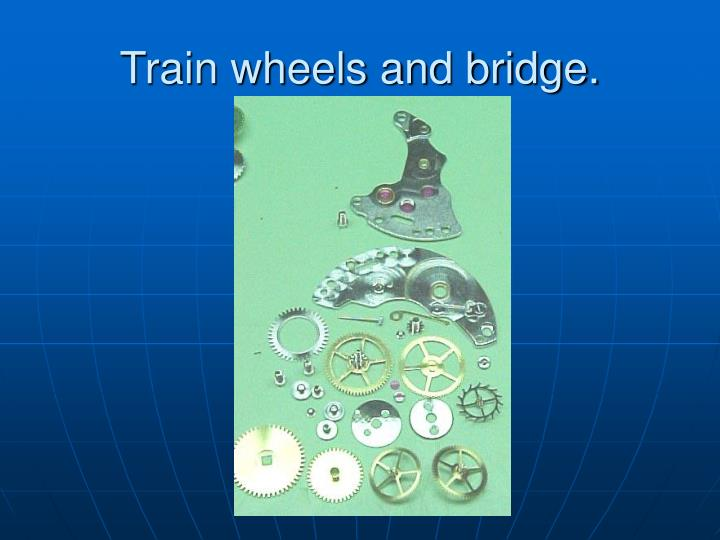 Train wheels and bridge.