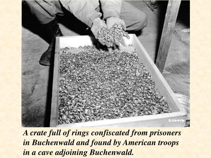 A crate full of rings confiscated from prisoners in Buchenwald and found by American troops in a cave adjoining Buchenwald.