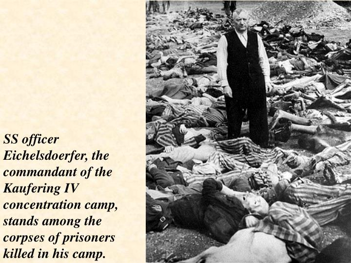 SS officer Eichelsdoerfer, the commandant of the Kaufering IV concentration camp, stands among the corpses of prisoners killed in his camp.