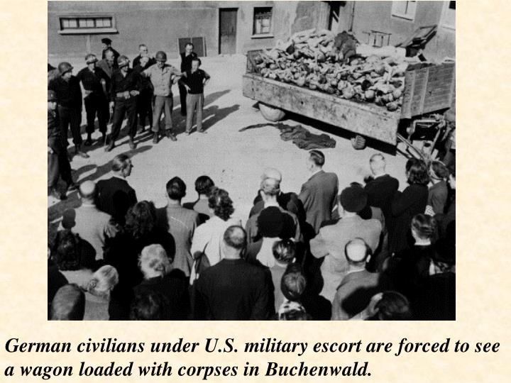 German civilians under U.S. military escort are forced to see a wagon loaded with corpses in Buchenwald.