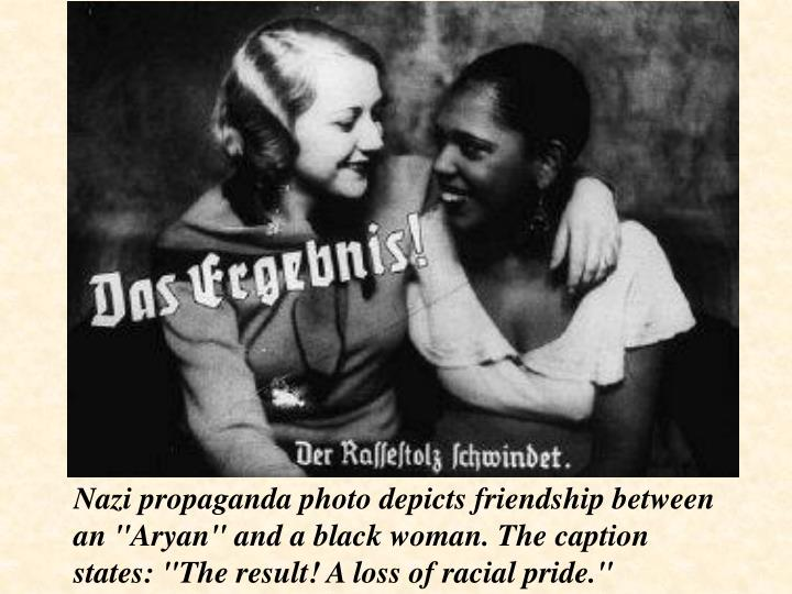 "Nazi propaganda photo depicts friendship between an ""Aryan"" and a black woman. The caption states: ""The result! A loss of racial pride."""