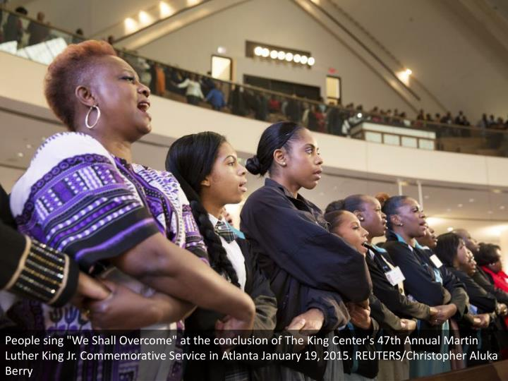"""People sing """"We Shall Overcome"""" at the conclusion of The King Center's 47th Annual Martin Luther King Jr. Commemorative Service in Atlanta January 19, 2015. REUTERS/Christopher Aluka Berry"""