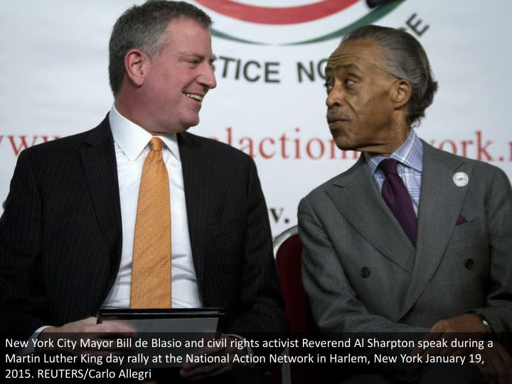 New York City Mayor Bill de Blasio and civil rights activist Reverend Al Sharpton speak during a Martin Luther King day rally at the National Action Network in Harlem, New York January 19, 2015. REUTERS/Carlo Allegri