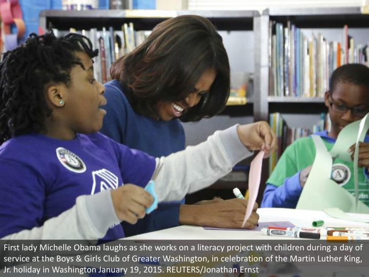 First lady Michelle Obama laughs as she works on a literacy project with children during a day of service at the Boys & Girls Club of Greater Washington, in celebration of the Martin Luther King, Jr. holiday in Washington January 19, 2015. REUTERS/Jonathan Ernst