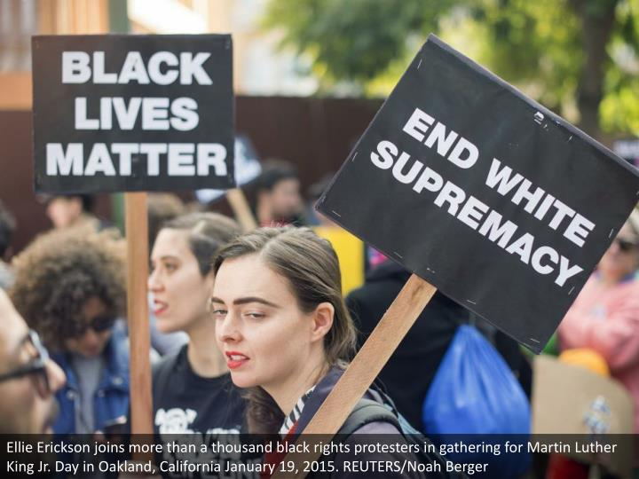 Ellie Erickson joins more than a thousand black rights protesters in gathering for Martin Luther King Jr. Day in Oakland, California January 19, 2015. REUTERS/Noah Berger