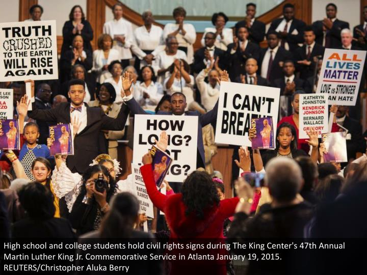 High school and college students hold civil rights signs during The King Center's 47th Annual Martin Luther King Jr. Commemorative Service in Atlanta January 19, 2015. REUTERS/Christopher Aluka Berry