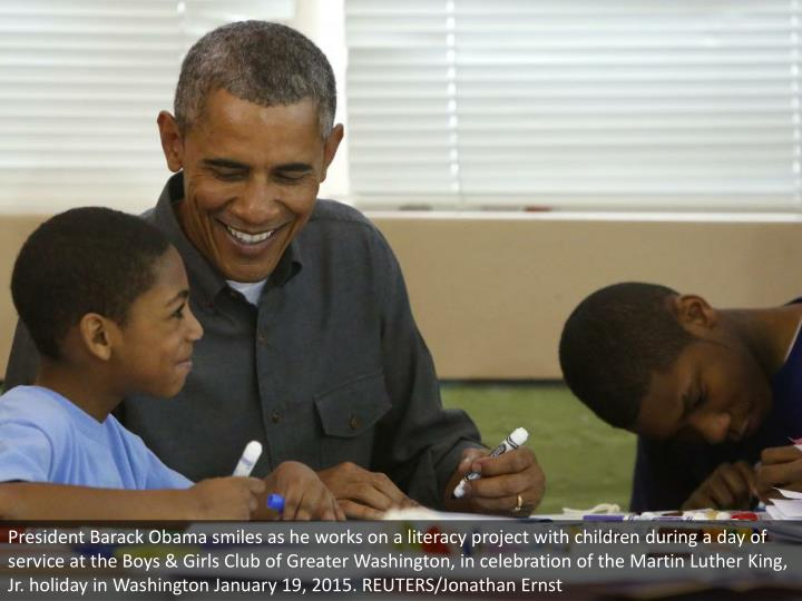 President Barack Obama smiles as he works on a literacy project with children during a day of service at the Boys & Girls Club of Greater Washington, in celebration of the Martin Luther King, Jr. holiday in Washington January 19, 2015. REUTERS/Jonathan Ernst