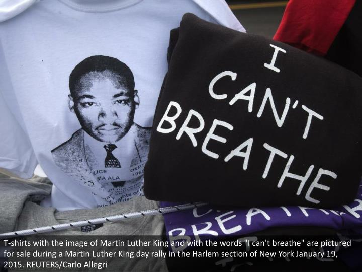"""T-shirts with the image of Martin Luther King and with the words """"I can't breathe"""" are pictured for sale during a Martin Luther King day rally in the Harlem section of New York January 19, 2015. REUTERS/Carlo Allegri"""