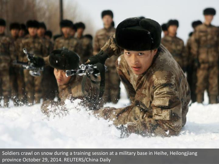 Soldiers crawl on snow during a training session at a military base in Heihe, Heilongjiang province October 29, 2014. REUTERS/China Daily