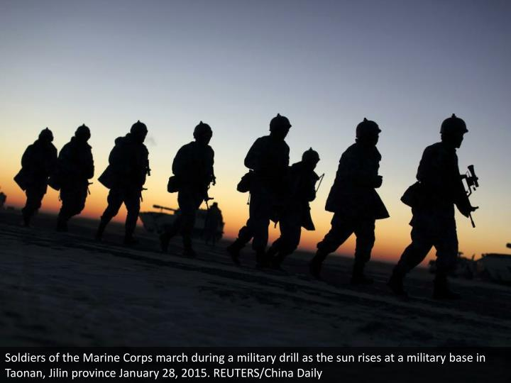 Soldiers of the Marine Corps march during a military drill as the sun rises at a military base in Taonan, Jilin province January 28, 2015. REUTERS/China Daily