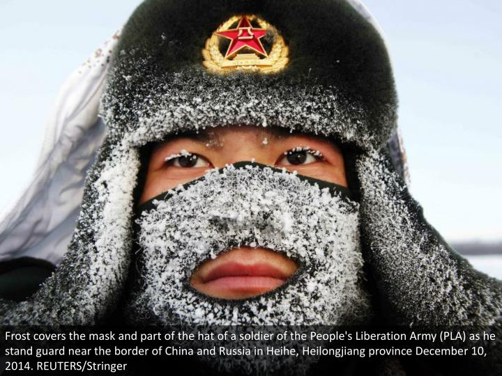 Frost covers the mask and part of the hat of a soldier of the People's Liberation Army (PLA) as he stand guard near the border of China and Russia in Heihe, Heilongjiang province December 10, 2014. REUTERS/Stringer