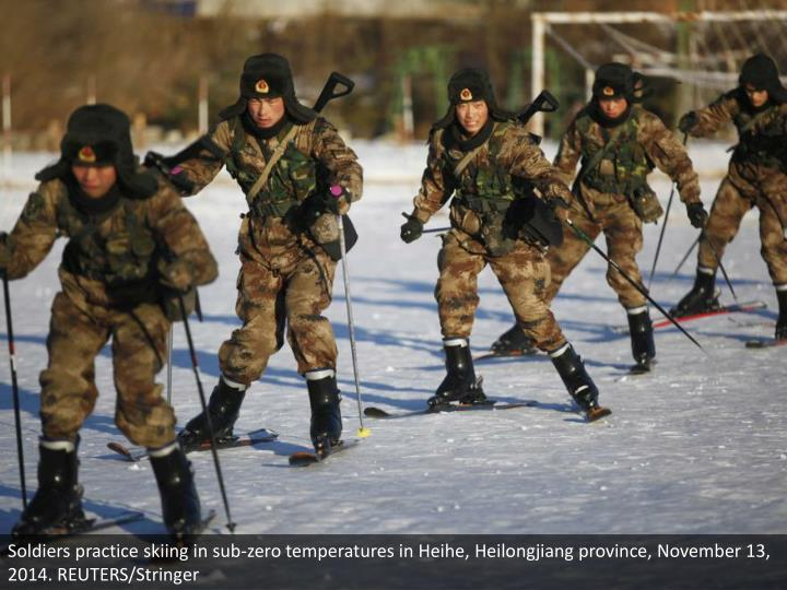 Soldiers practice skiing in sub-zero temperatures in Heihe, Heilongjiang province, November 13, 2014. REUTERS/Stringer