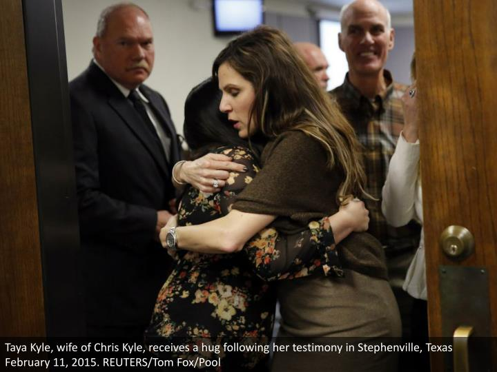 Taya Kyle, wife of Chris Kyle, receives a hug following her testimony in Stephenville, Texas February 11, 2015. REUTERS/Tom Fox/Pool