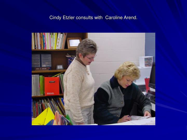 Cindy Etzler consults with  Caroline Arend.
