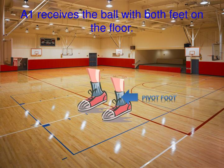 A1 receives the ball with both feet on the floor.