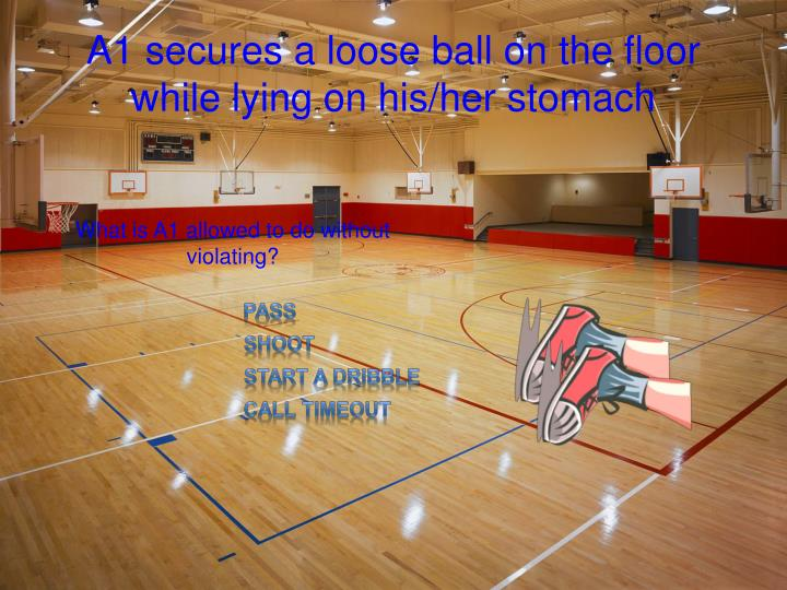 A1 secures a loose ball on the floor while lying on his/her stomach