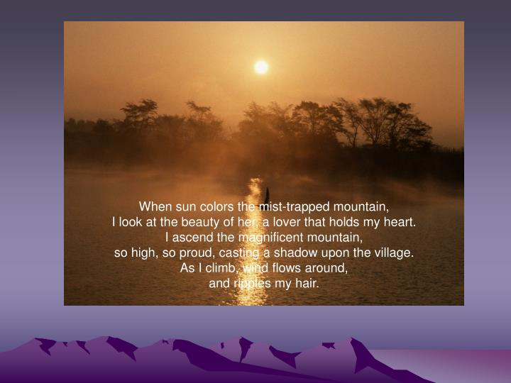 When sun colors the mist-trapped mountain,