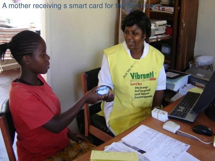 A mother receiving s smart card for the first time