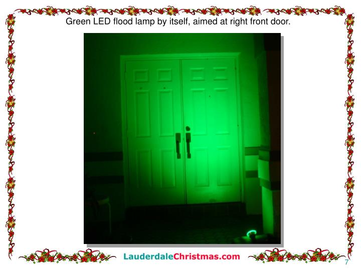 Green LED flood lamp by itself, aimed at right front door.