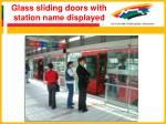 glass sliding doors with station name displayed
