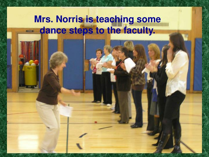 Mrs. Norris is teaching some dance steps to the faculty.