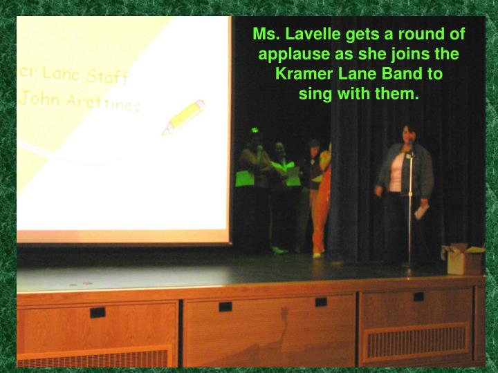 Ms. Lavelle gets a round of applause as she joins the Kramer Lane Band to
