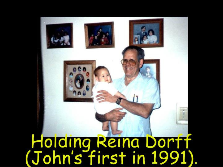 Holding Reina Dorff (John's first in 1991)