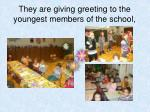 they are giving greeting to the youngest members of the school