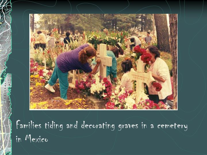 Families tiding and decorating graves in a cemetery in Mexico