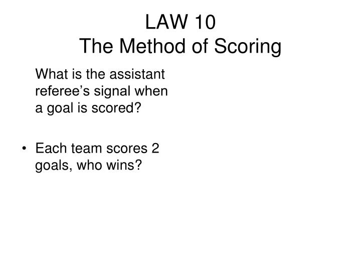 What is the assistant referee's signal when a goal is scored?