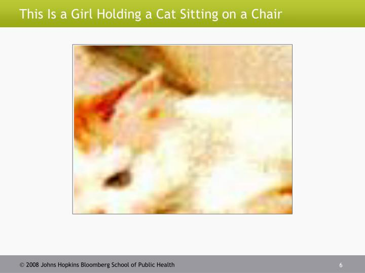 This Is a Girl Holding a Cat Sitting on a Chair