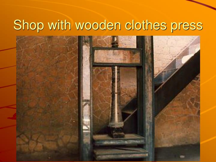 Shop with wooden clothes press
