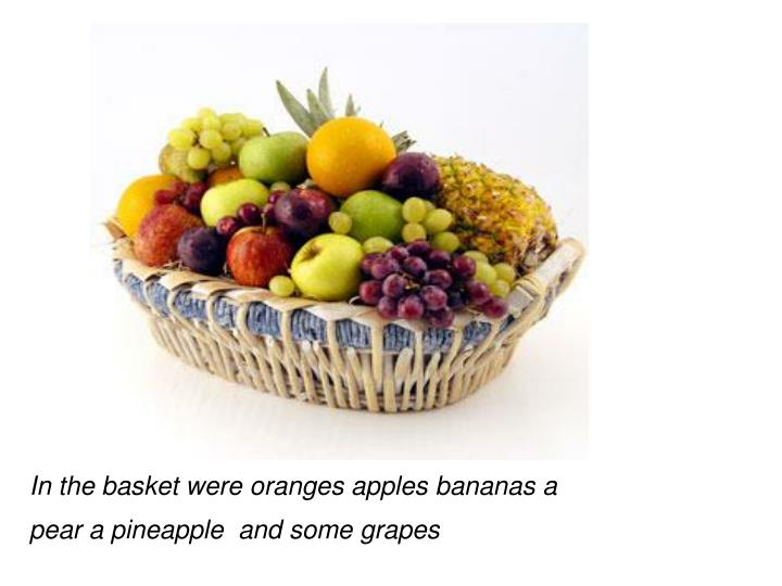 In the basket were oranges apples bananas a pear a pineapple  and some grapes
