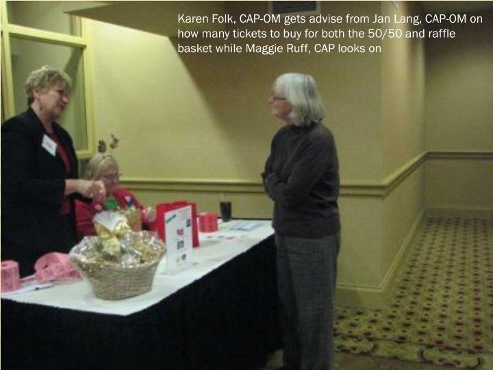 Karen Folk, CAP-OM gets advise from Jan Lang, CAP-OM on how many tickets to buy for both the 50/50 and raffle basket while Maggie Ruff, CAP looks on
