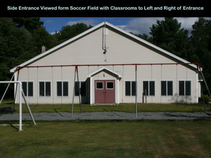 Side Entrance Viewed form Soccer Field with Classrooms to Left and Right of Entrance