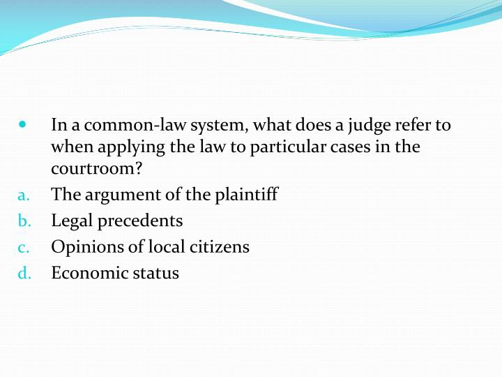 In a common-law system, what does a judge refer to when applying the law to particular cases in the courtroom?