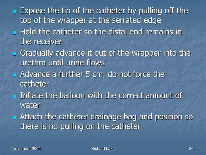 Expose the tip of the catheter by pulling off the top of the wrapper at the serrated edge