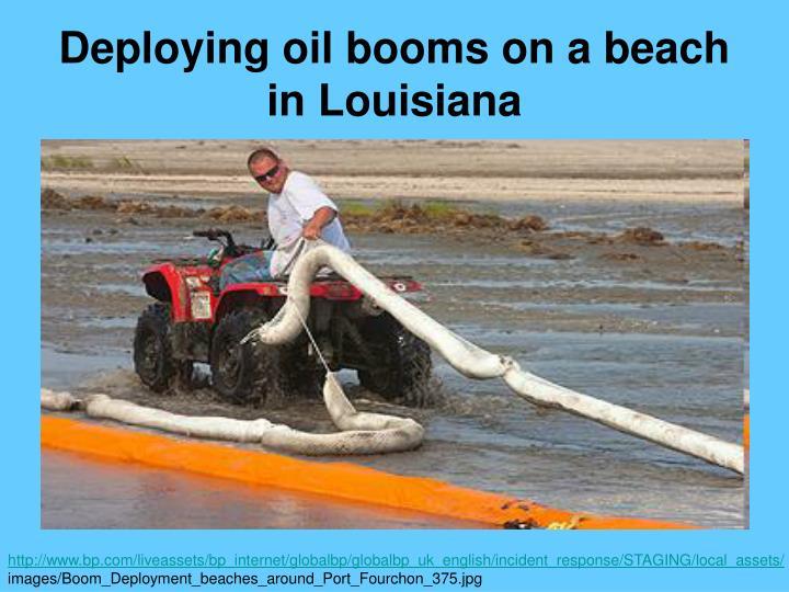 Deploying oil booms on a beach in Louisiana