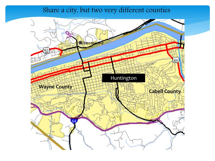 Share a city, but two very different counties