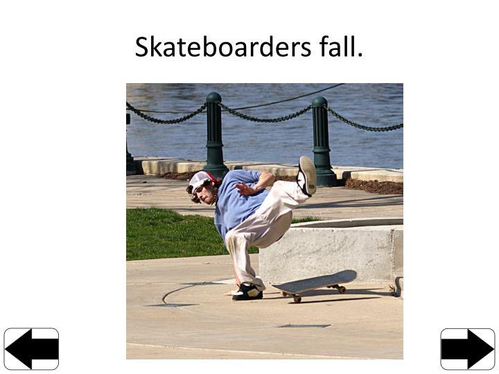 Skateboarders fall.