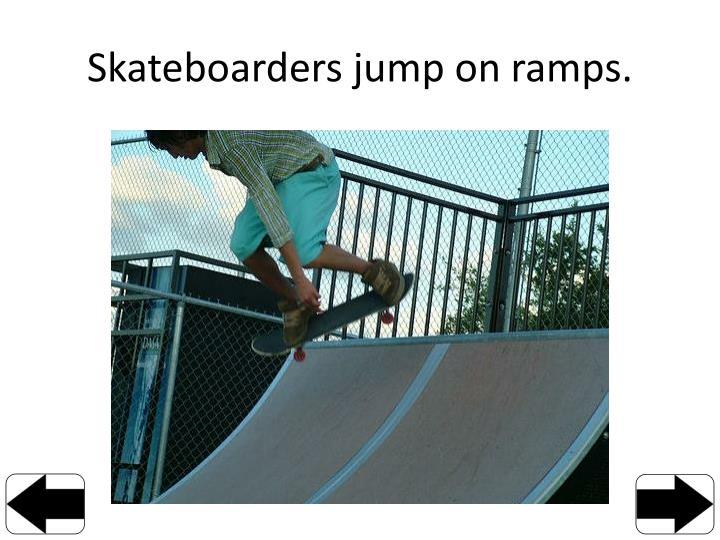 Skateboarders jump on ramps.