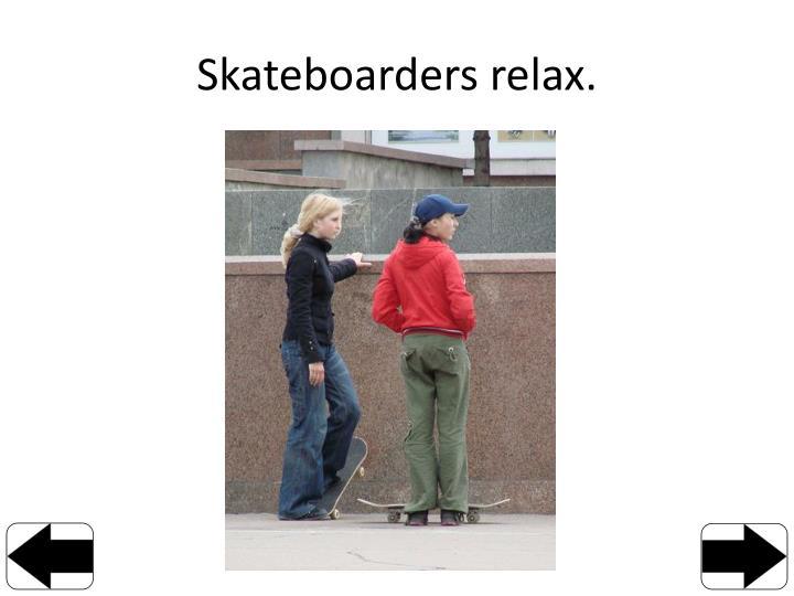 Skateboarders relax.